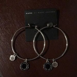 New hoop silver earring with black logo
